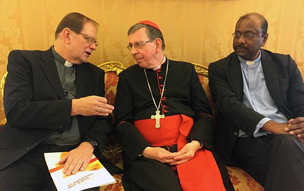 WCRC General Secretary Chris Ferguson talks with Cardinal Kurt Koch while WCRC President Jerry Pillay looks on